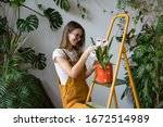 Young smiling woman gardener in ...