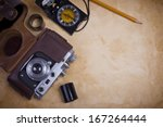 old camera with filmstrip and... | Shutterstock . vector #167264444