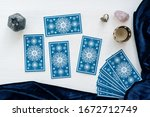 tarot cards on the white wooden ... | Shutterstock . vector #1672712749