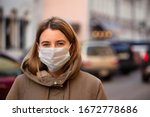 Woman Wearing Face Mask During...