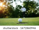 Blurred Golfer Playing Golf In...