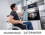 Small photo of Disabled Man Using Grabber Tool To Control Microwave In Kitchen