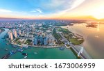 Coastal Urban Scenery of Haikou City with Landmark Buildings, Parks and Bridges at Sunset, the Capital City of Hainan Province, a Pilot Free Trade Zone and Tourism Destination in China. Aerial View.