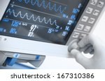 Small photo of medical electronics. Monitor with ECG curves