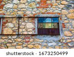 Colorful Window Of An Old Barn...