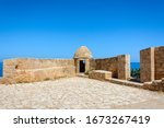 a paved area with stone walls...   Shutterstock . vector #1673267419