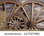 Old Wheels From A Cart In Shed