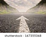 arrow on asphalt road to the...