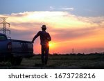 Rear View Of Silhouette Farmer...