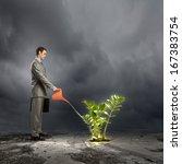 image of businessman watering... | Shutterstock . vector #167383754