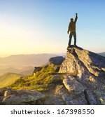 winner on the mountain top.... | Shutterstock . vector #167398550