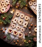 Small photo of Linzer Christmas cookies filled with red currant marmalade, top view
