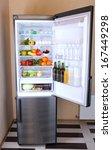 refrigerator full of food | Shutterstock . vector #167449298
