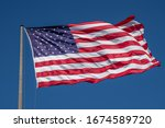 American Flag Waving In Blue...
