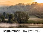 Small photo of Sunrise, Stonewall Jackson Lake, Stonewall Resort, Near Roanoke, West Virginia; the Stonewall Jackson Resort is a real gem (Four-Diamond Rated).