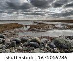 Small photo of Ebb tide Road on the wadden sea to the island Mandoe, Esbjerg Denmark