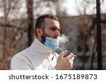 A Guy In An Antiviral Mask...