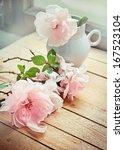 White Roses In A Vase In...