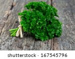 Tied Fresh Parsley On Wooden...