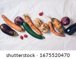 Small photo of Ugly organic rotten vegetables with mutations on craft paper background. Concept of zero waste production. Copy space. Spoiled non gmo vegetables with dots. Compost