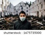 Small photo of Coronavirus covid-19 pandemic consequence.Homeless woman.Economic and social crash concept.Epidemic quarantine due to coronavirus covid-19 outbreak.Psychological stress of infectious disease.Fear