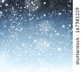 Stock photo winter background with blured snowflakes 167581229