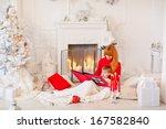 christmas eve. mother reading... | Shutterstock . vector #167582840