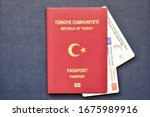 Small photo of Surface Passport of Turkey, Turkish identity card and Driving Licence of Turkey on blue background