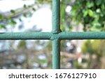 Green Iron Wall In The Garden.