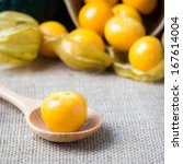 still life vegetable, Cape gooseberry organic fresh vegetable display on sack cloth - stock photo
