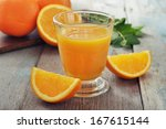 orange juice in glass with mint ... | Shutterstock . vector #167615144