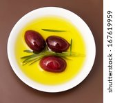 Bowl Filled With Olive Oil And...