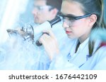 young female scientist looking...   Shutterstock . vector #1676442109