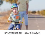 Cheerful Little Boy In Helmet...