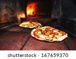 pizzas baked in wood oven. | Shutterstock . vector #167659370