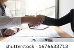 Small photo of Businessmen shaking hand in the office room, Business etiquette, Congratulation, Greeting and Dealing concept.