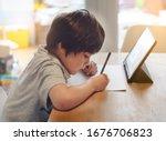 Portrait of preschool kid using ...