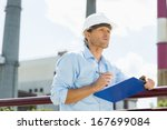 male architect with clipboard... | Shutterstock . vector #167699084