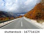 Straight Asphalt Road With...