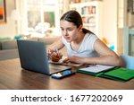 Teenager girl studying online...