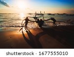 Silhouette Of Fishermen With...