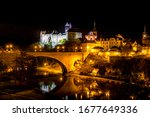 Small photo of night view on a town Loket and Loket Castle (Hrad Loket, Burg Elbogen), impregnable castle on a massive rock, illuminated by street lamps. Tourist spot near to Karlovy vary, Czechia