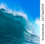 Blue Ocean Wave At Sunny Day