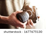 Man holding dslr camera. Camera lens attaching. Lens mount. - stock photo