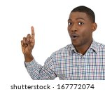 Small photo of Closeup portrait of surprised young man who just came up with an idea aha, index finger pointing up, isolated on white background. Positive human emotions, facial expressions, feelings, symbols, signs