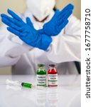 Small photo of Scientists wear blue gloves and make hands unacceptable vaccine Selective focus