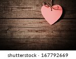 Stock photo pink heart made of paper on wooden background 167792669