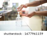 Small photo of Nurse hands using wash hand sanitizer gel pump dispenser before nursing care a patient in hospital ward,Disinfection concept.