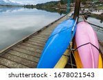 Colorful Kayaks On A Dock In...