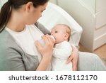 Pretty Woman Holding A Newborn...